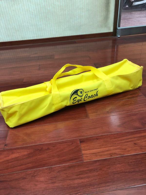 Billie Jean King's Eye Coach yellow carry bag