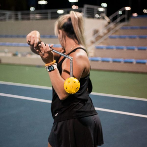 A woman training with Wrist Racquet