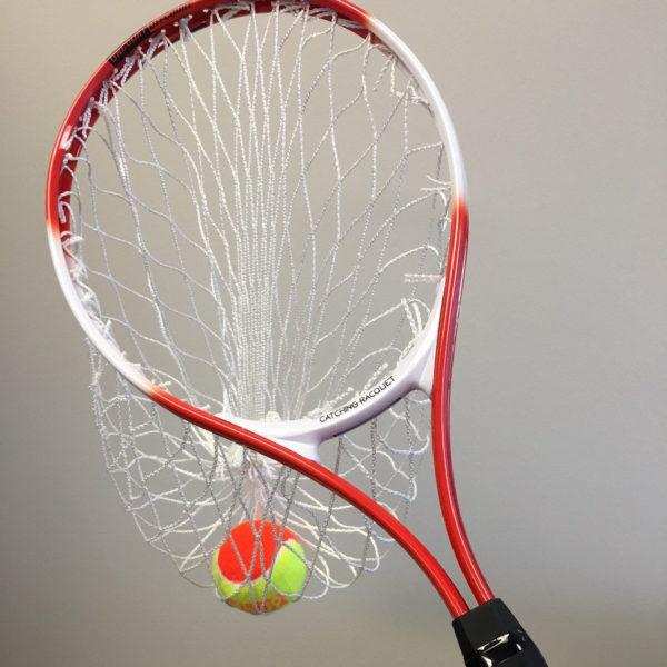 Catching racquet with tennis balls